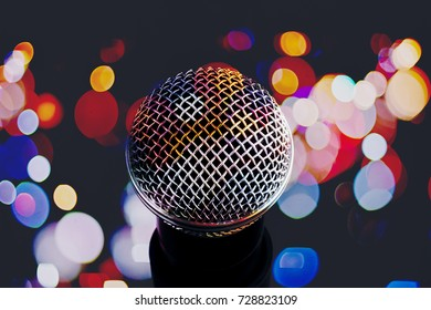 microphone on background of a bright colored lights