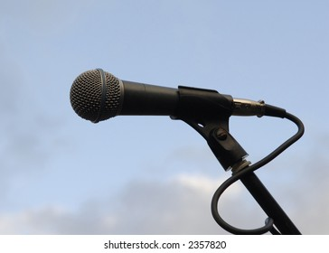 Microphone on blue sky