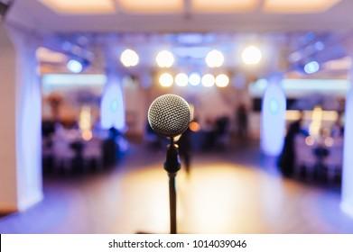 Microphone on blurred of speech in seminar room