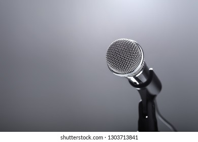 Microphone on grey background. Singing and music. Auditioning and performing.