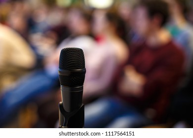 Microphone on humans background.