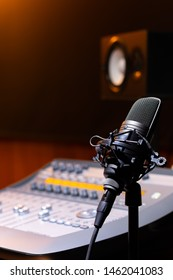 microphone on mixing console and loudspeaker monitor background. recording concept