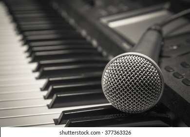 microphone on piano background.