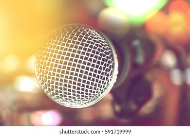 microphone on stage against soft light and blurred background