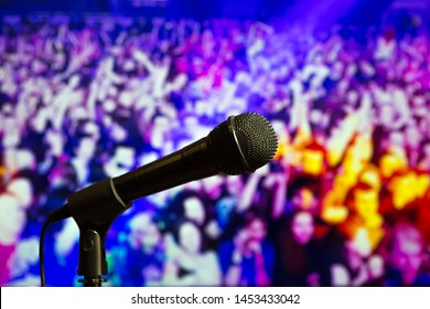 Microphone on stage with the background of people. Live perfomance.
