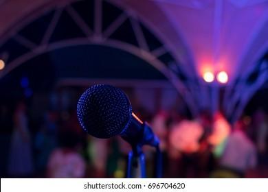 Microphone. Microphone on stage. Microphone close-up. A pub. Bar. A restaurant. Classical music. Music
