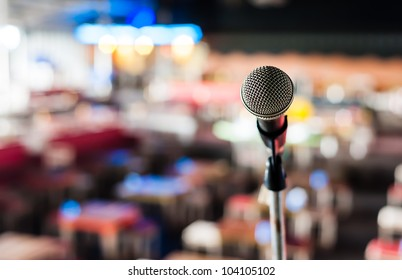 Microphone on stage in club with background