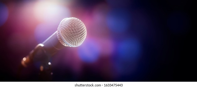 Microphone on stage at concert or music performance background