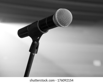 microphone on the stage and empty hall during the rehearsal black and white photo