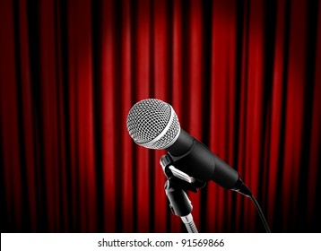 microphone on stage with red curtain
