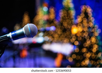 Microphone on stage with twinkle lights in background