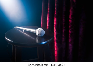 microphone on a stool in a stand up comedy stage with reflectors ray, high contrast image