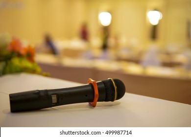 Microphone on the table in the conference room.