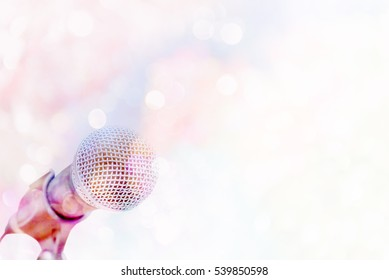 microphone on vivid bokeh  background with copy space