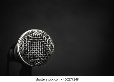 Microphone on wallpaper  background with copy space.