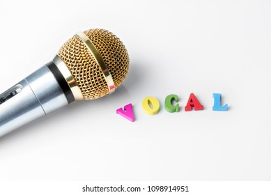 Microphone on a white background, close-up, genre vocals.