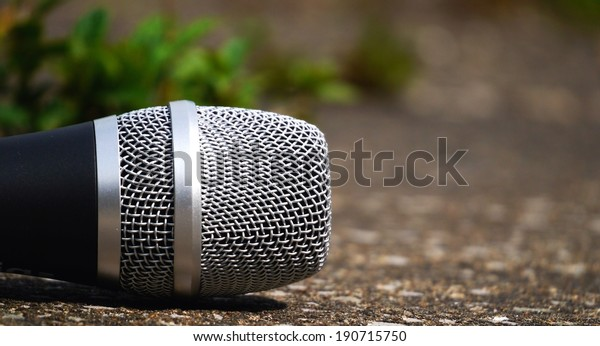 Microphone in open air environment, ready to sing outdoor gig.