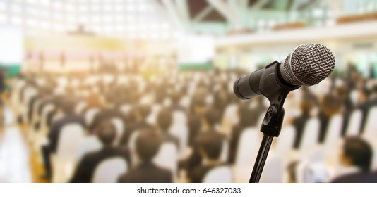 Microphone over the blurred business conference hall or seminar room, Blurred background