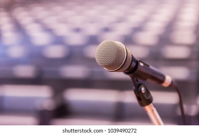 Microphone over the blurred business forum Meeting or Conference Training Learning Coaching Room Concept, Blurred background