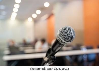 Microphone over the blurred business forum Meeting or Conference Training Learning Coaching Room Concept, Blurred background.