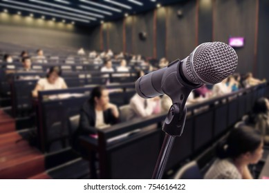 Microphone over the blurred business people forum Meeting Conference Training Learning or Coaching Concept, Blurred background
