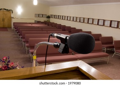 Microphone at the podium with empty pews