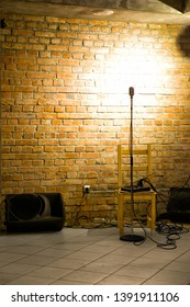 Microphone ready on stage against a brick wall ready for the Karaoke performer