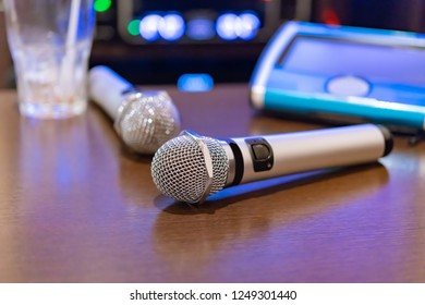 Microphone and remote control in karaoke box