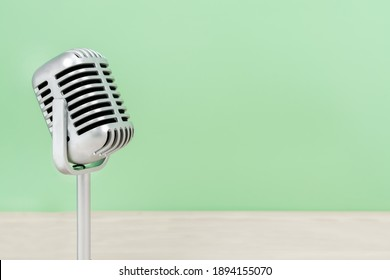 Microphone retro with copy space on table and greed background