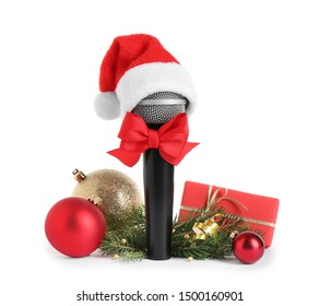 Microphone with Santa hat and decorations isolated on white. Christmas music concept