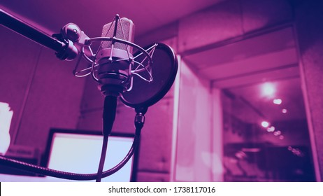 Microphone and shock mount and pop filter on tripod which use in sound production recording studio for vocalist or narrator or dj on brodcasting or professional creator live online channel