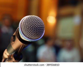 Microphone soft focus on blur student background in meeting room, business and educational concept