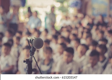 Microphone soft focus on blur abstract background lecture hall/ seminar meeting room in business event/ educational academic classroom training course/ soft focus picture / Vintage concept