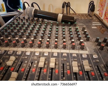 Microphone with sound mixing console, sound engineer