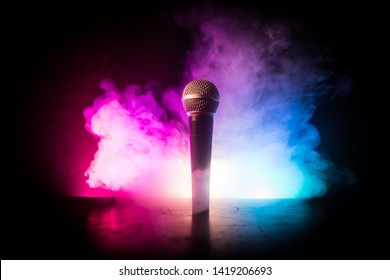 Microphone for sound, music, karaoke in audio studio or stage. Mic technology. Voice, concert entertainment background. Speech broadcast equipment. Live pop, rock musical performance - Shutterstock ID 1419206693