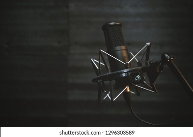 Microphone in a sound recording studio room background.