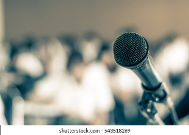 Microphone speaker in seminar meeting room or lecture hall classroom