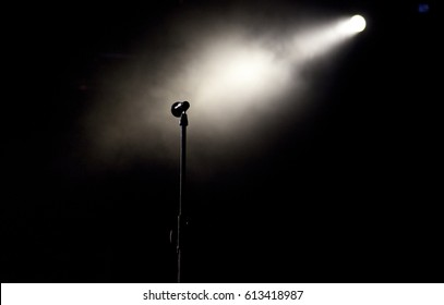 microphone in stage lights during concert