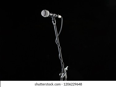 Microphone stand, microphone voice, closeup mic. Karaoke, concert, voice music. Vocal audio mic on a black background. Singer in karaokes, microphones. Live music, audio equipment, sing sound.