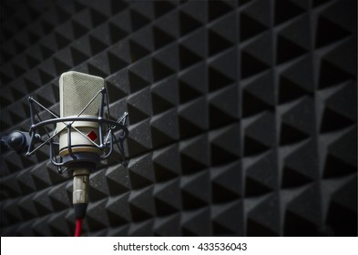 microphone in the studio with acoustic panels
