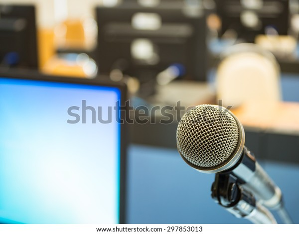 Microphone in training room with blur computer.