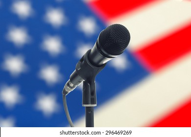 Microphone with US flag on background - studio shot
