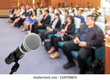 Microphone voice speaker with audiences or students in seminar classroom, lecture hall or conference meeting in educational business event for host, teacher, or coaching mentor.