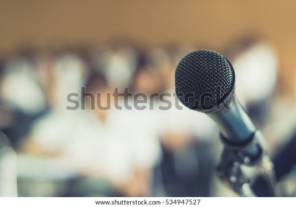 Microphone voice speaker with audiences or students in seminar classroom, lecture hall or conference meeting in educational business event for host, teacher, or coaching mentor