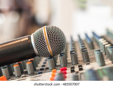 Microphone voice speaker on audio synthesisers electronic music instrument sound mixer machine in broadcasting studio room, seminar event  or wedding ceremony party