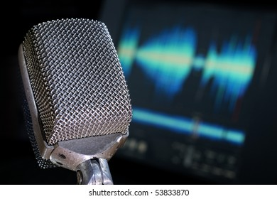 Microphone with waveform and audio computer background.