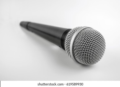 Microphone with a wire isolated on white background. Silver professional microphone for studio.