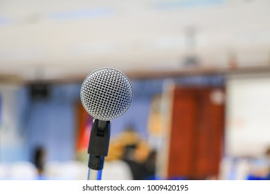 microphone wireless in a meeting room seminar conference background: Select focus with shallow depth of field.
