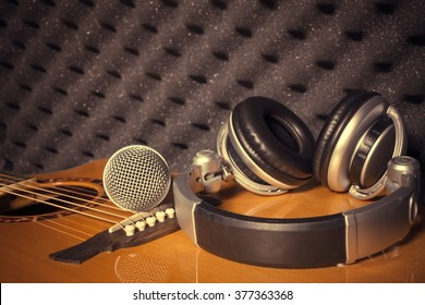microphone,headphone on classic guitar  background in home recording studio.