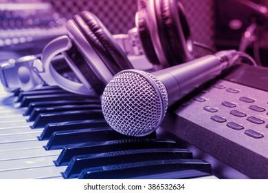 microphone,headphone on piano background.